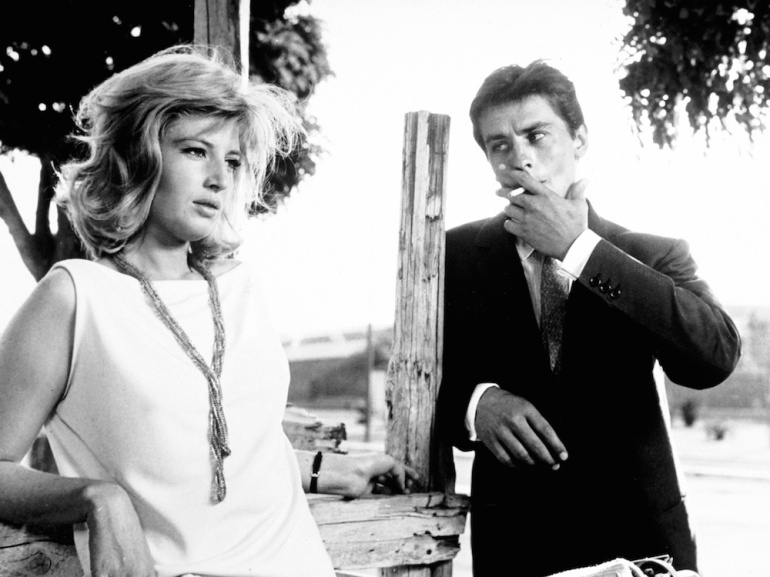 eclisse-l-1962-004-monica-vitti-alain-delon-smoking-1000x750